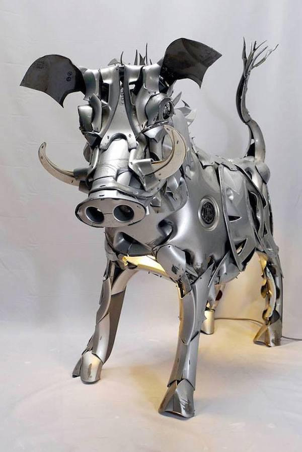 boar sculpture hubcaps